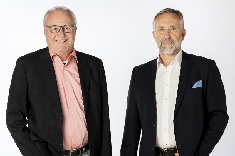 Bernd Konschak und Thaddäus Rohrer vor weißem Hintergrund